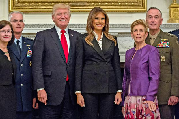 US President Donald Trump with wife Melania and senior military leaders. Photo: Bloomberg