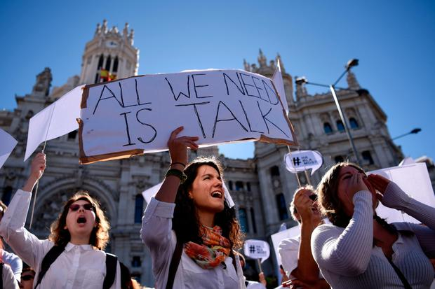 Dialogue: Peaceful protesters chanting 'Let's talk' at a demonstration at Cibeles Square in Madrid. Similar marches across the country called on Catalan and Spanish cooperation. Photo: Getty Images