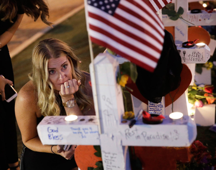 Mystified grief: A woman mourns at a makeshift memorial in Las Vegas