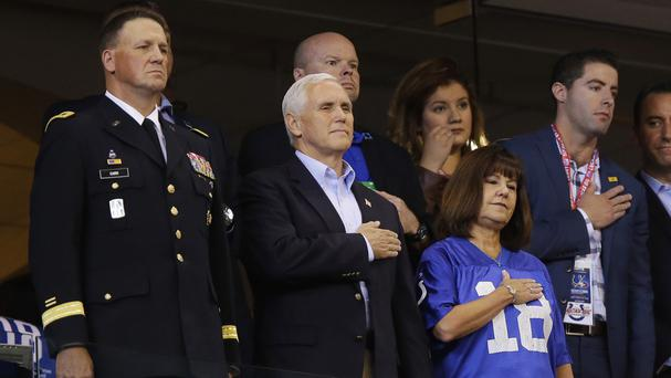 Mike Pence stands during the playing of the national anthem before an NFL football game between the Indianapolis Colts and the San Francisco 49ers (AP Photo/Michael Conroy)