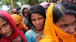 Rohingya women wait for food handouts at Thangkhali refugee camp in Cox's Bazar, Bangladesh, after fleeing Burma (Zakir Hossain Chowdhury/AP)