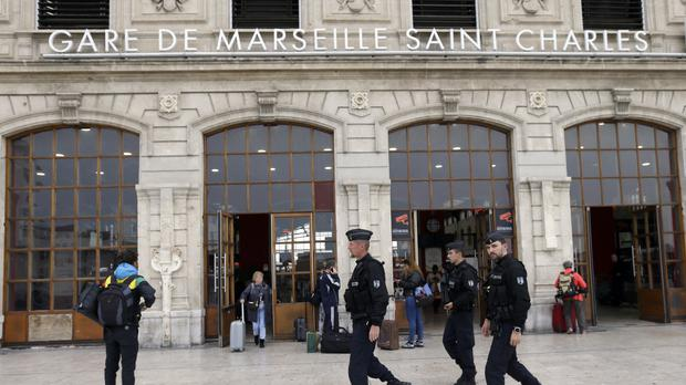 Police officers outside Marseille's Saint Charles railway station after a man fatally stabbed two women (AP Photo/Claude Paris)