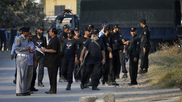 Pakistani police arrive to ensure security at an accountability court in Islamabad (AP Photo/Anjum Naveed)