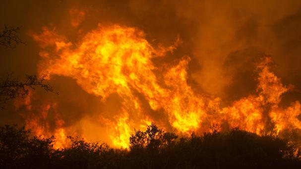 Flames from a wildfire burn in Napa, California (AP)