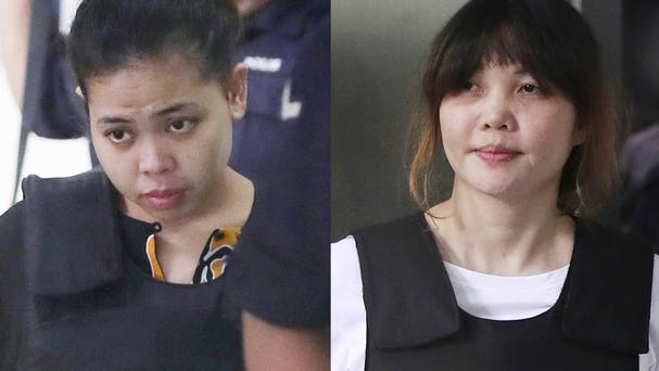 Indonesian Siti Aisyah, left, and Vietnamese Doan Thi Huong, right, are on trial accused of murdering Kim Jong Nam, the estranged half-brother of North Korea leader Kim Jong Un (AP Photo/Daniel Chan)