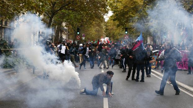 Demonstrators face tear gas during a protest in Paris (AP)