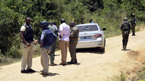 Armed security officers at the scene of the shooting south of Mombasa (AP)