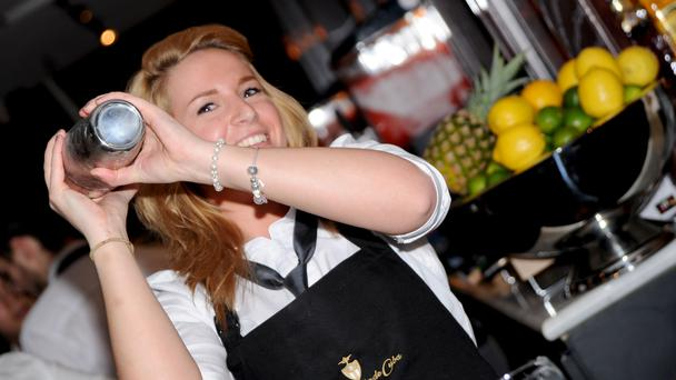 A cocktail waitress at a Revolucion de Cuba, which is part of the Revolution Bars Group