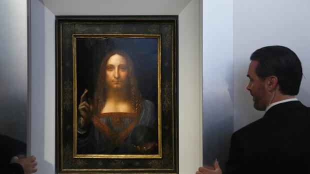 Security guards open a door to reveal Salvator Mundi (AP/Seth Wenig)