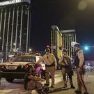 Police at the scene of the mass shooting outside the Manda   lay Bay hotel on the Las Vegas Strip (AP Photo/John Locher, File)