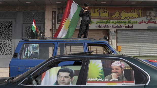 A boy with a Kurdish flag in the disputed Iraqi city of Kirkuk (AP)