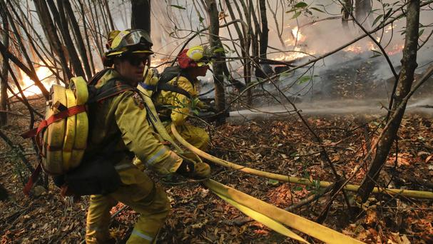 Firefighters put out a hot spot from a wildfire near Calistoga (Jae C. Hong/AP/PA)