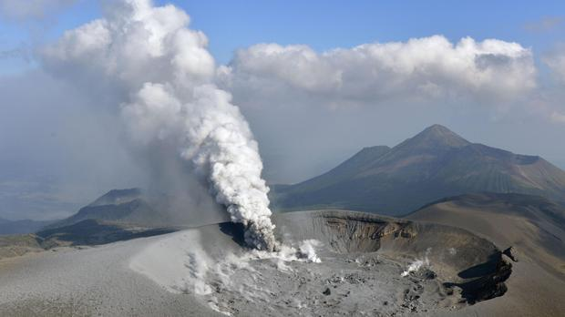 Volcanic smoke rises from the Shinmoedake volcano after its eruption on the border of Kagoshima and Miyazaki prefectures in south-western Japan (Tomoaki Ito/Kyodo News via AP)