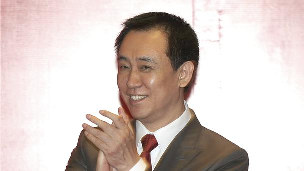 Evergrande China founder Xu Jiayin attending a 2015 news conference for the Guangzhou Evergrande football team (AP)
