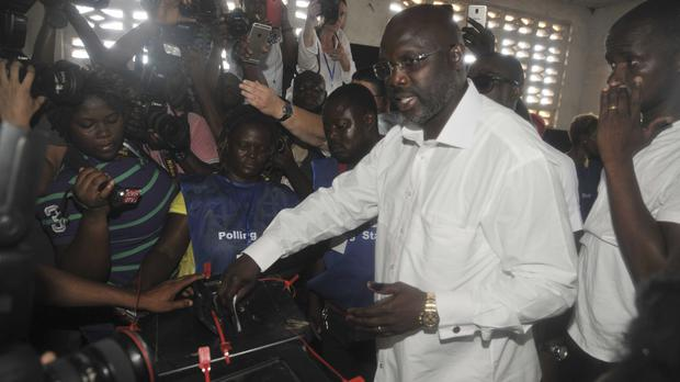 Former footballer George Weah, of the Coalition for Democratic Change, is leading Liberia's presidential election (AP Photo/Abbas Dulleh, File)