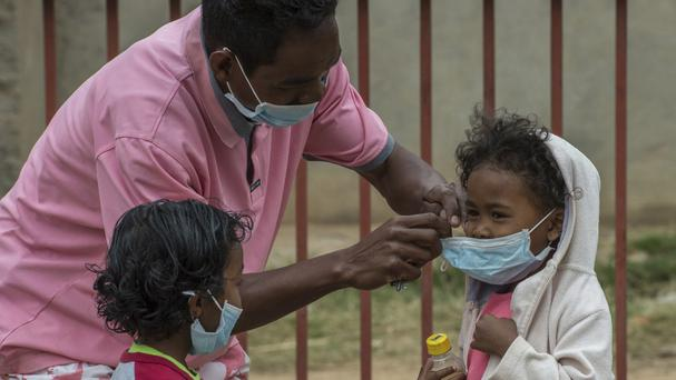 Face masks are placed on children in Antananarivo, Madagascar (AP)