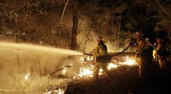 Fire crews battle a wildfire in California (AP)