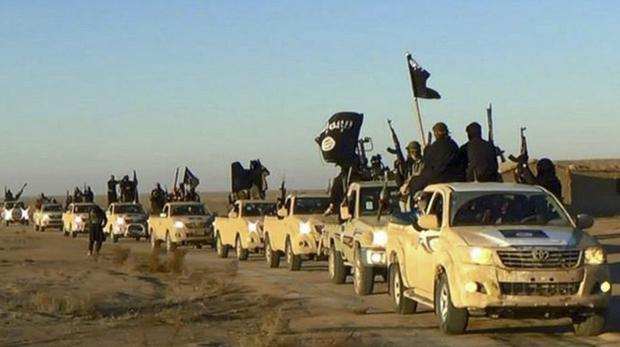 Islamic State militants in Raqqa, Syria (Militant website/AP)