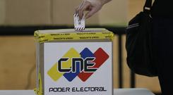 Venezuela's National Electoral Council says candidates for the ruling socialist party have won a majority of the 23 governors' offices (Ariana Cubillos/AP)