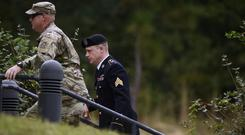 Sergeant Bowe Bergdahl, right, arrives for a motions hearing (AP)