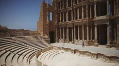 A Libyan man walks through the Roman amphitheatre at Sabratha (AP)