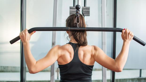 A generic photo of the back of a woman in the gym (PA)