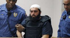 File picture of Ahmad Khan Rahimi being led into court (AP)