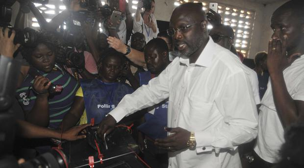 Ex-footballer George Weah and vice-president to contest Liberia's presidency