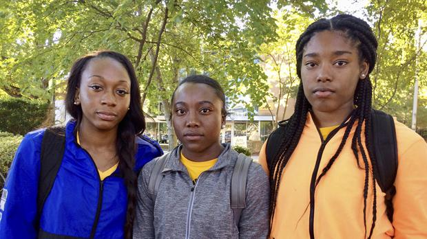 Kennesaw State University cheerleaders, from left to right, Shlondra Young, Tommia Dean and Kennedy Town (AP)