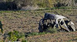 The wreckage of the car of investigative journalist Daphne Caruana Galizia (AP)