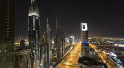 A view of the skyline at night in Dubai