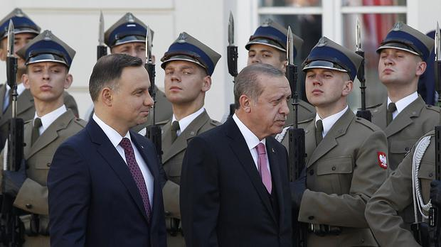 Visiting Turkey's president Recep Tayyip Erdogan, right, and his Polish host president Andrzej Duda, left, walking before the guard of honour (AP)