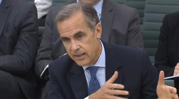 Mark Carney signals rate hike in 'coming months' and urges Brexit transition deal