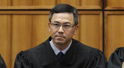 US District Judge Derrick Watson blocked the Trump administration from enforcing its latest travel ban, just hours before it was set to take effect (George Lee /The Star-Advertiser via AP, File)