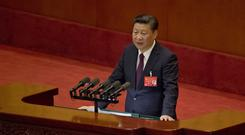 Chinese president Xi Jinping delivers a speech at the opening ceremony of the 19th Party Congress in Beijing (AP)