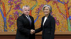 South Korean foreign minister Kang Kyung-wha, right, shakes hands with US deputy secretary of state John Sullivan (AP/Ahn Young-joon)