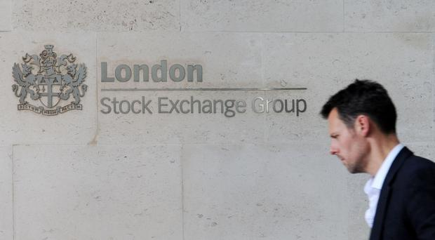 Weak pound pushes FTSE 100 close to record high