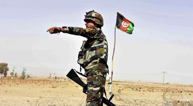 Afghan National Amy commandos open fire (AP)