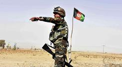 An Afghan National Army soldier a checkpoint on the way to Zhari district (AP)