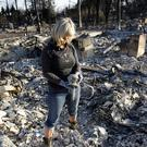 Debbie Wolfe in the burned ruins of her home in Santa Rosa (AP)