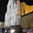 A mortuary van leaves the Basilica Santa Croce in Florence (AP)