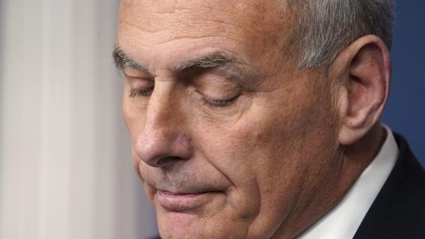 White House Chief of Staff John Kelly pauses as he speaks to the media (AP)
