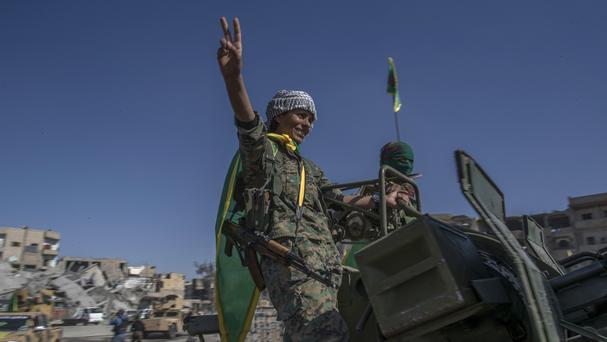 Fighters from the Women's Protection Units, or YPJ, hold a celebration in Paradise Square in Raqqa (AP)