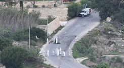 Daphne Caruana Galizia was killed by a car bomb as she left her home (AP)