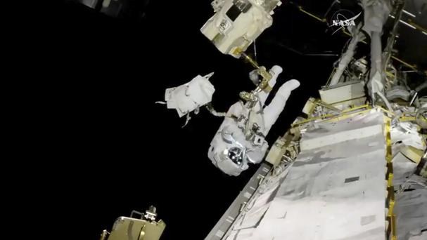 Astronaut Joe Acaba performs a spacewalk outside the International Space Station (AP)