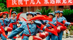 People dressed in Red Army uniforms performing to celebrate the opening of the 19th Party Congress in Yiyang in China's central Jiangxi province. The slogan reads