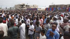 Thousands of Somalis gather to pray at the site of the country's deadliest terror attack (AP)