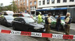 Police guard the area at Rosenheimer Platz square in Munich (AP)