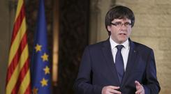 Catalan President Carles Puigdemont made a veiled independence threat during a statement at the Palau Generalitat in Barcelona (Ruben Moreno/Presidency Press Service, Pool Photo via AP)