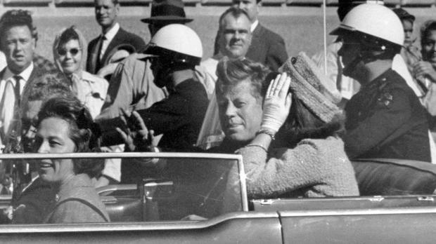 President John F Kennedy waves from his car in a motorcade in Dallas on November 22 1963 (AP Photo/Jim Altgens, File)